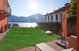 Bank repossessions residential in Southern Europe. Apartment with a private garden and a lake view, Tremezzo