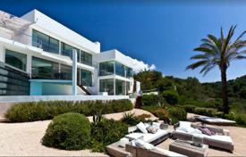 3 bedroom houses for sale in Ibiza. Three-level villa with a view of the mountains, on the first line from the sea, Cala Vedella, Ibiza, Spain