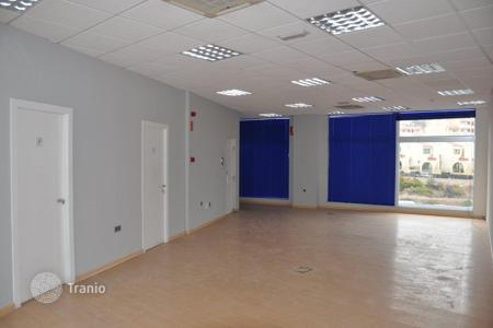 Commercial property for sale in Canary Islands. Premises in a shopping center, with a terrace and windows overlooking a busy street, Tenerife, Spain