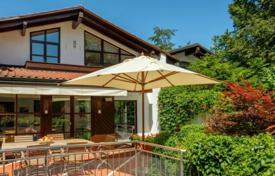 Luxury 6 bedroom houses for sale in Central Europe. Large house with a winter garden, a fireplace, a sauna, a terrace and a garage in the prestigious district of Grünwald, Munich, Germany