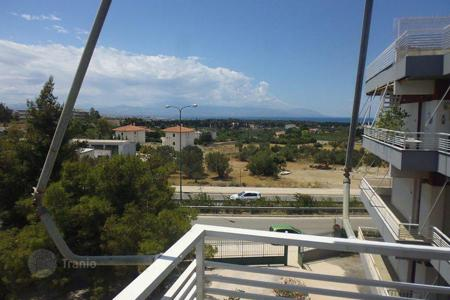 Cheap residential for sale in Administration of the Peloponnese, Western Greece and the Ionian Islands. Apartment with sea view and roof top terrace, in Loutrakion, Greece