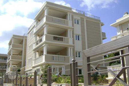 Coastal apartments for sale in Greece. Elegant two-level apartments in Athens, Greece. Large balconies and terraces, garage, guarded residential complex