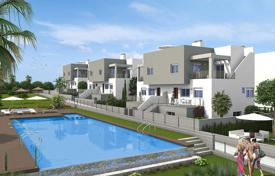 Coastal property for sale in Valencia. New three-level townhouses with a solarium and a garden in Torrevieja, Aguas Nuevas area