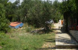 Development land for sale in Trogir. Land plot with a sea view and an access to the beach, Trogir, Croatia