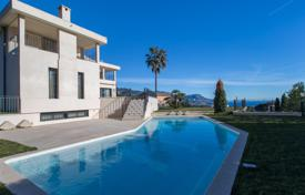 5 bedroom houses for sale in Côte d'Azur (French Riviera). Modern roomy villa with panoramic sea view, a garden and a pool on the slope of Mon Boron hills, Nice, France