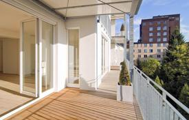 Property for sale in North Rhine-Westphalia. Three-bedroom apartment in Dusseldorf, Germany. Flat with a fireplace, a terrace and a panoramic view, in a historic district