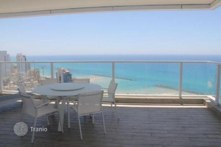 New homes for sale in Center District. Modern furnished apartment with a terrace and with stunning views of the sea and the city of Netanya, Israel