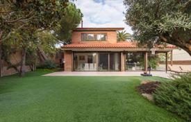 Luxury houses for sale in Barcelona. Exclusive villa with a private plot, a garden, a swimming pool and a garage in a prestigious area, Barcelona, Spain