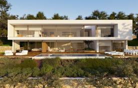 Off-plan houses for sale in Spain. Modern villa with panoramic windows, a swimming pool, a garden and a sea view, Blanes, Spain
