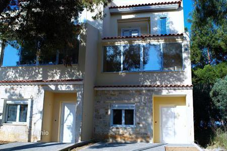Property for sale in Attica. A three-storey cottage on the first line in Attica