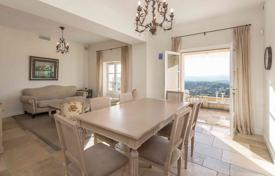 Cheap apartments for sale in France. Bright renovated apartment with a spacious terrace and panoramic views of the hills in the medieval village, Mougins, France
