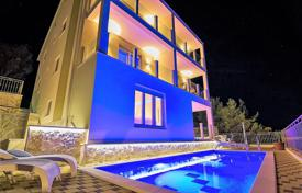 Coastal houses for sale in Split-Dalmatia County. Spacious villa with a private garden, a swimming pool, a Jacuzzi, a parking and sea views, Ciovo, Croatia