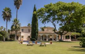 Great family home set amongst stunning mature lawned gardens on a double plot in the heart of Sotogrande Costa for 2,450,000 €