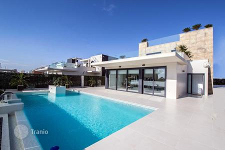 Houses for sale in Dehesa de Campoamor. Designer villa with private swimming pool and sea views in Campoamor