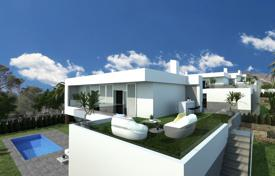 Houses with pools for sale in Finestrat. New two-level villa overlooking the sea in Finestrat, Alicante, Spain
