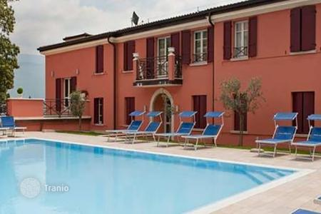 Hotels for sale in Italian Lakes. Luxury hotel with restaurant, private beach and two swimming pools on the western shores of Lake Garda