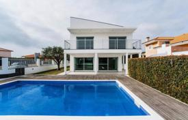 5 bedroom houses for sale in Lisbon. New villa with garden and pool in a gated community in a quiet area of Birre, Cascais, Portugal