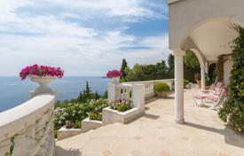 5 bedroom houses for sale in Côte d'Azur (French Riviera). Comfortable seaview villa with a large garden, a pool, a sauna and a garage, Cap-d'Ail, France