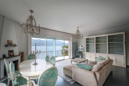 5 bedroom houses for sale in Europe. Villa with garden, overlooking the Monte Rosa and its own dock and access to the beach of Lake Maggiore, in the center of Ranco, Italy