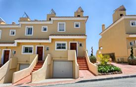 Townhouses for sale in Costa del Sol. Townhouse with a garden, a garage and a terrace, Benahavis