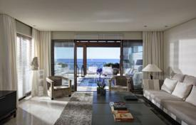5 bedroom apartments for sale in Andalusia. Duplex penthouse with a swimming pool and sea views in a residence with a garden and a gym, on the first line from the sea, Estepona, Spain