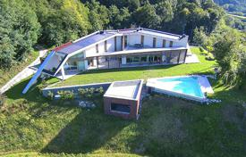 Coastal houses for sale in Friuli-Venezia Giulia. Modern villa with wine cellar, vinery and breathtaking view over plain and Alpine foothill in Udine region, Italy
