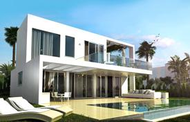 Off-plan houses with pools for sale in Southern Europe. Modern villa with a private garden, a pool, a garage, a terrace and a sea view, Mijas, Spain