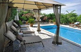 Coastal houses for sale in Split-Dalmatia County. Spacious villa with a private garden, a swimming pool, a barbecue and a sea view, Brac, Croatia