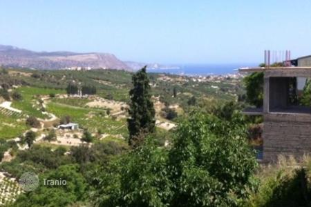 Coastal development land for sale in Heraklion. Land in the village Vutes with sea and mountain views