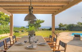 Luxury 5 bedroom houses for sale in Administration of the Peloponnese, Western Greece and the Ionian Islands. Beachfront villa in Porto Cheli, Greece. House with direct access to the beach, a swimming pool and a garden, in a small elite residence