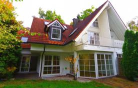 Houses for sale in Germany. Spacious house with a private garden and two underground garages in the prestigious area of Grünwald, Munich, Germany