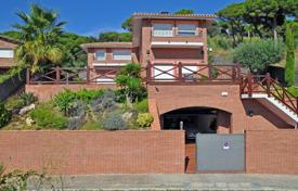4 bedroom houses by the sea for sale in Catalonia. Spacious villa with a garden, a swimming pool, terraces, a gym and a garage, near the beach, Barcelona, Spain