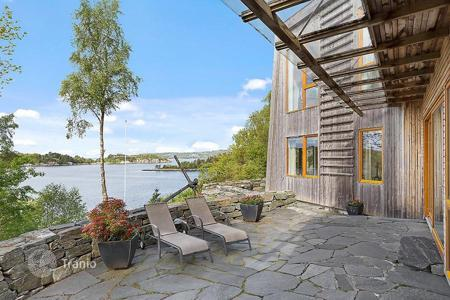 Luxury residential for sale in Norway. The author's architectural design — spacious comfortable house on the beach, West Coast Stavanger