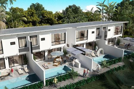 Residential for sale in Thailand. Villa in a condominium surrounded by tropical plants and a magnificent view of the sea in the area of Plai Laem