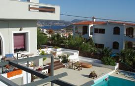 Coastal residential for sale in Lagonisi. Sea view estate with two buildings, a large swimming pool and a landscaped garden, Lagonissi, Greece