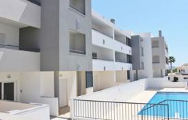 Apartments with pools for sale in Faro. Two-bedroom apartment with ocean views in a new building with a swimming pool, Albufeira, Portugal