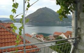 2 bedroom apartments by the sea for sale in Kotor. Perast apartment with the beautiful big 15 m² terrace of stunning sea view. The apartment is in need of work but with great potential.