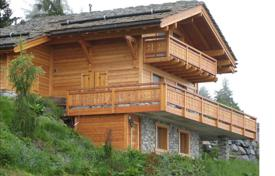 Luxury chalets for sale overseas. Comfortable chalet with a terrace, a balcony and a jacuzzi, overlooking the mountains, next to the ski slopes, Nendaz, Switzerland