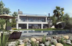 Houses with pools by the sea for sale in Costa del Sol. New two-storey villa with terraces, a swimming pool and sea views, close to the beach, Benalmadena, Spain