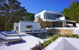 Luxury villas and houses for rent with swimming pools in Ibiza. Sunny, modern villa with panoramic sea views, architectural terrace, swimming pool and garden on a hill in Cala Moli, Ibiza