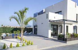 Coastal houses for sale in Costa Blanca. Modern villa with terrace, solarium and swimming pool, in Torrevieja, Alicante, Spain