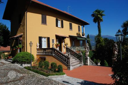 5 bedroom houses for sale in Italy. Ancient villa of the late XIX century, with its own park and a terrace overlooking Lake Maggiore in Baveno, Italy