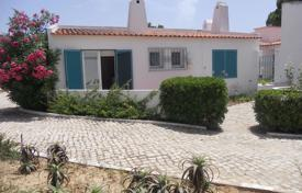Houses with pools for sale in Faro. Spacious villa with a terrace, 200 meters from the beach, Faro, Portugal