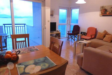 3 bedroom apartments for sale in Croatia. Furnished apartment with a spacious panoramic balcony located on the front coastline, Komarna, Croatia