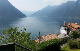 Apartments for sale in Colonno. A Luxury apartment with stunning lake and mountain views in Colonno