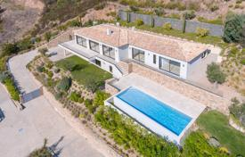 4 bedroom houses for sale in Grimaud. Modern new villa overlooking the sea with a private garden, a swimming pool, a garage and many terraces, Saint-Tropez, France