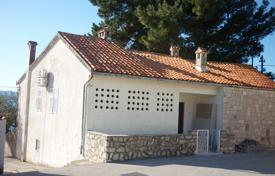 Development land for sale in Split-Dalmatia County. Spacious plot overlooking the sea with an old house, Bol, Croatia