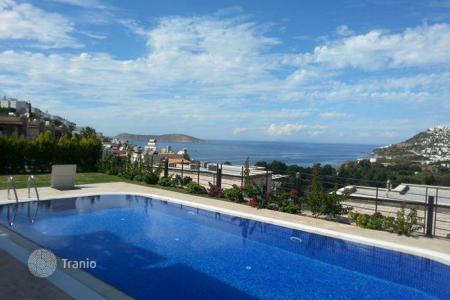 Off-plan residential for sale overseas. New sea view detached house with a garden and a pool, in a modern residence with around-the-clock security and a marina, Gümüslük, Turkey