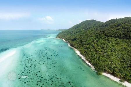 Land for sale in Thailand. The site overlooks the bay near Taling Ngam