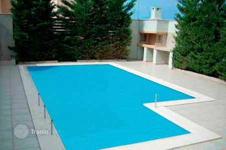 Houses with pools by the sea for sale in Attica. Comfortable detached house with a swimming pool and a garden, at 50 meters from the sea, Lagonissi, Greece